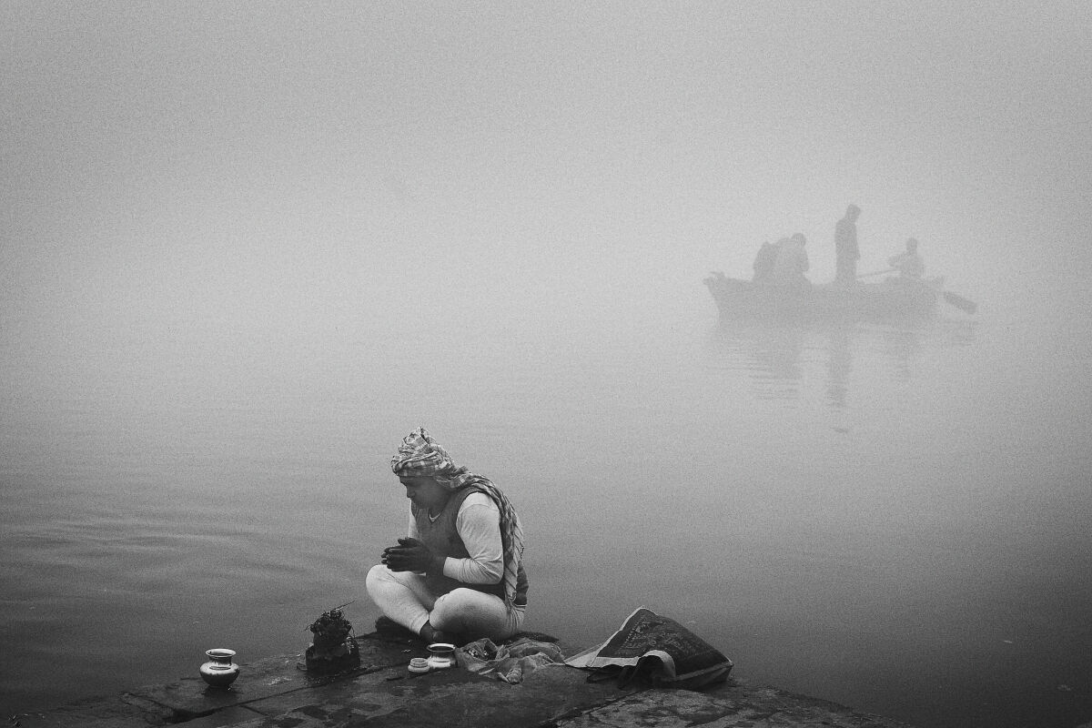 Morning Puja on the banks of the Ganga River. Varanasi, India.